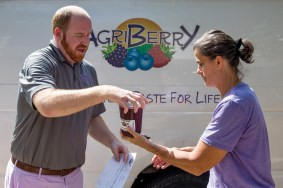 Evelyn's owner Brandon Stalker accepting a curbside delivery from Susan Noyce of Agriberry Farms on September 26, 2018.