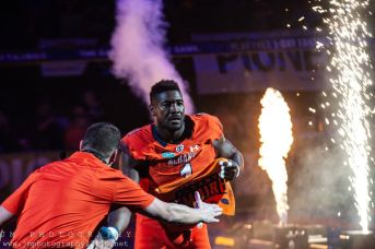 Albany Empire defensive end Joe Sykes enters the field prior to Saturday's game. Photo: Jon Monaghan/UC Sports