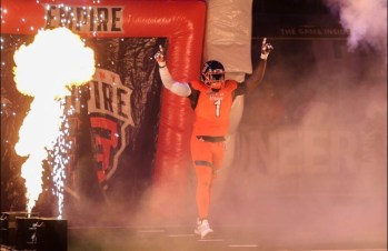 Defensive linemen Joe Sykes enters the field during pre game introductions. Photo: Robert Dungan/ The Upstate Courier