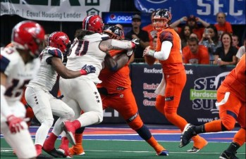 Quarterback Tommy Grady dropping back for a pass during Saturday's game against the Washington Valor. Photo: Robert Dungan/ The Upstate Courier