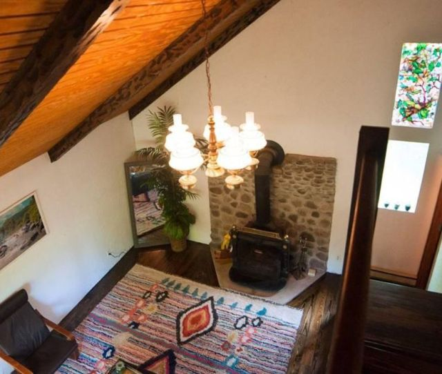 For The Five Figure Price Tag You Get A Turn Key Interior With Vaulted Ceilings Wood Floors Stained Glass Wood Stove With Stone Backsplash And A Big
