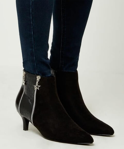 Model wearing black pointed toe boots with slender 6cm heel by Joe Browns. Suedette is paired with a snakeskin effect side panel and 2 zips with star shaped charms.