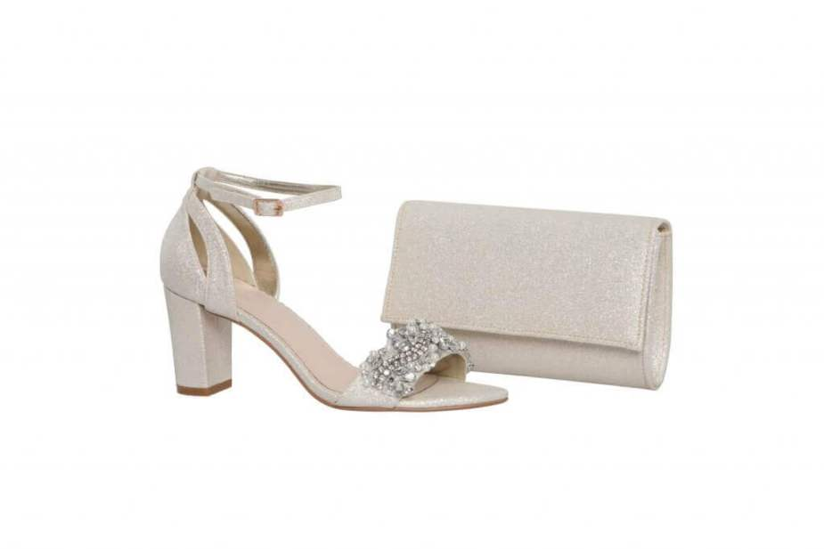 Perfect Bridal gold sparkle shoe with block heel and ankle strap alongside matching clutch handbag