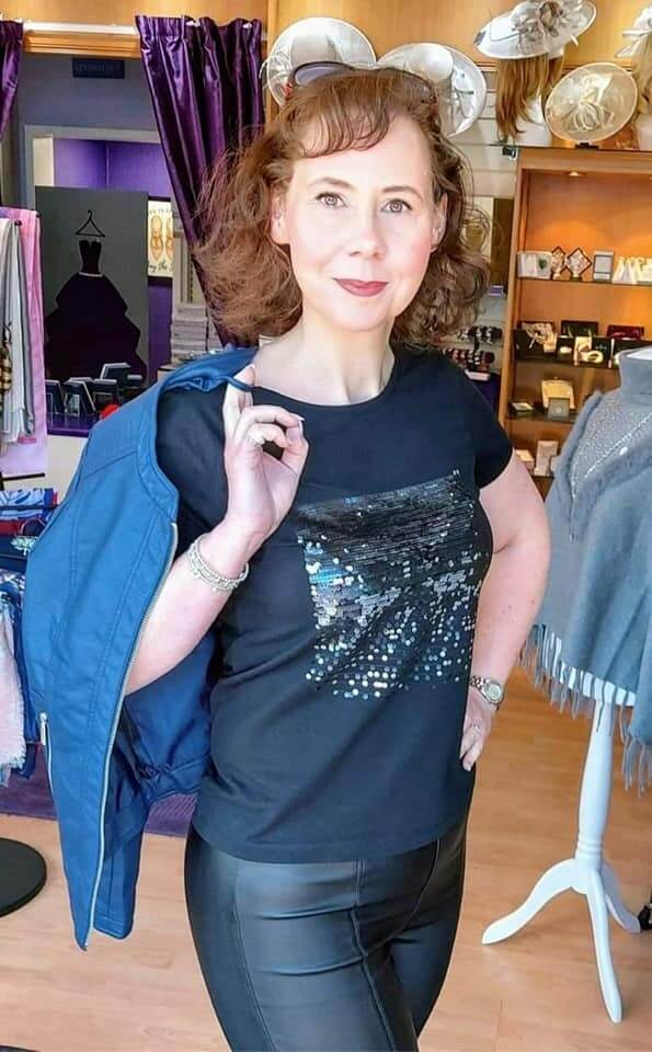 Model wearing black t-shirt with sparkle design on front