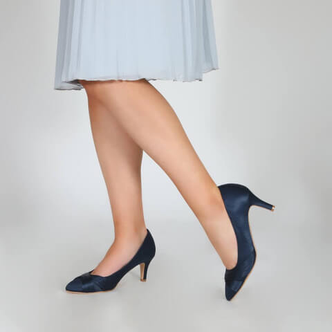 Perfect Bridal navy satin court shoes with mid high heels. Decorated with woven crisscross satin bands on the toe area