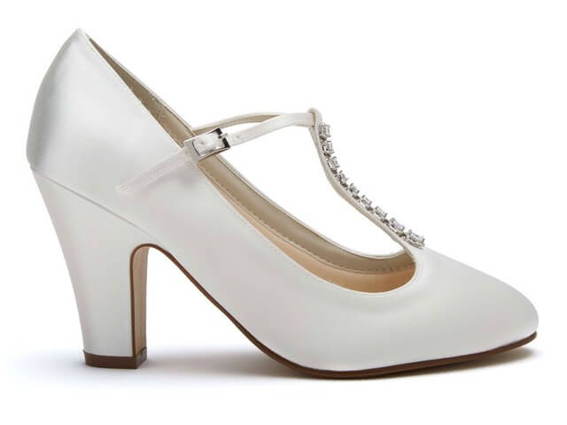 Rainbow Club Frankie ivory satin bridal shoe. These T-bar wedding shoes have a round toe, a high block heel, and are embellished with a sparkling row of diamantes along the T-bar straps