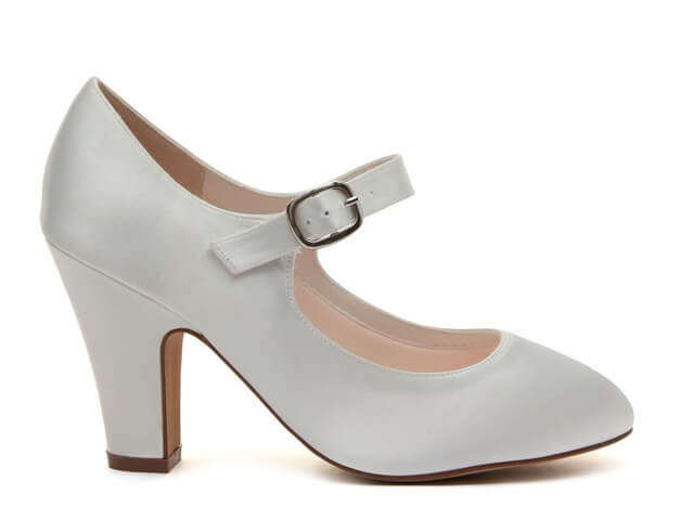 Rainbow Club Madeline ivory satin bridal shoe. Features a chic almond toe, a comfortable but shapely block heel and an ankle strap with stylish silver buckle