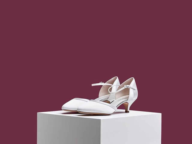 Rainbow Club Brianna ivory satin bridal shoes. They have an almond toe, a chic low heel and delicate ankle strap