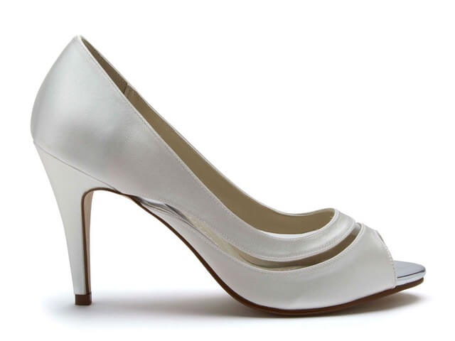 Rainbow Club Eloisa ivory bridal shoe. Has a peep toe, a high stiletto heel and chic vinyl detail which curves around the foot