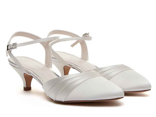 Rainbow Club Julie ivory satin bridal shoes. Is a sling back shoe with an almond toe and stylish kitten heel