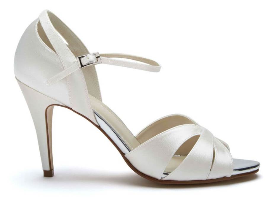 Rainbow Club Sue ivory satin bridal sandals. These feature a peep toe front, stiletto heel, cut out detail across the front and to the back of the heels and fasten with a delicate ankle strap