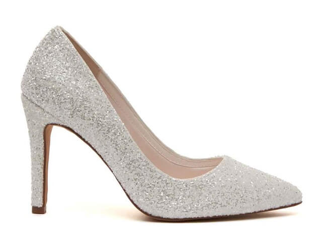Rainbow Club Coco bridal shoes crafted in ivory snow glitter. Has pointed toes, a contemporary, streamlined shape and stiletto heels
