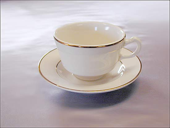 Gold Rimmed Coffee Cup  Uptown Rentals