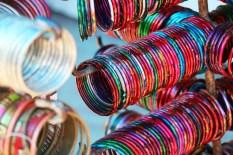 Stacks of coloured bangles.
