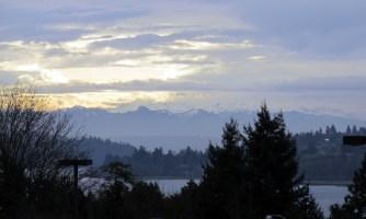 Mount Rainier hides under clouds.