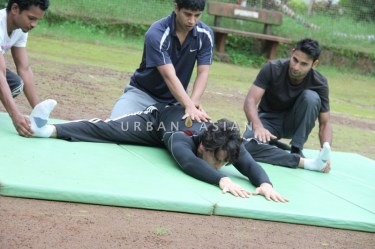 Tiger Shroff with his trainer, Ziley Mawai (centre)