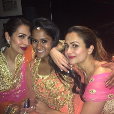 arpita, amrita and malaika at soha ali khan's wedding