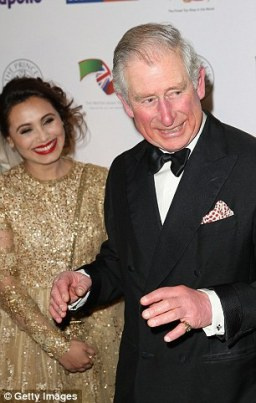 Prince Charles and Rani Mukerji share a joke.