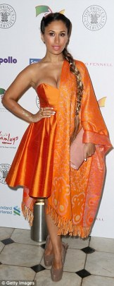 Preeya Kalidas shows off her beautiful orange dress!