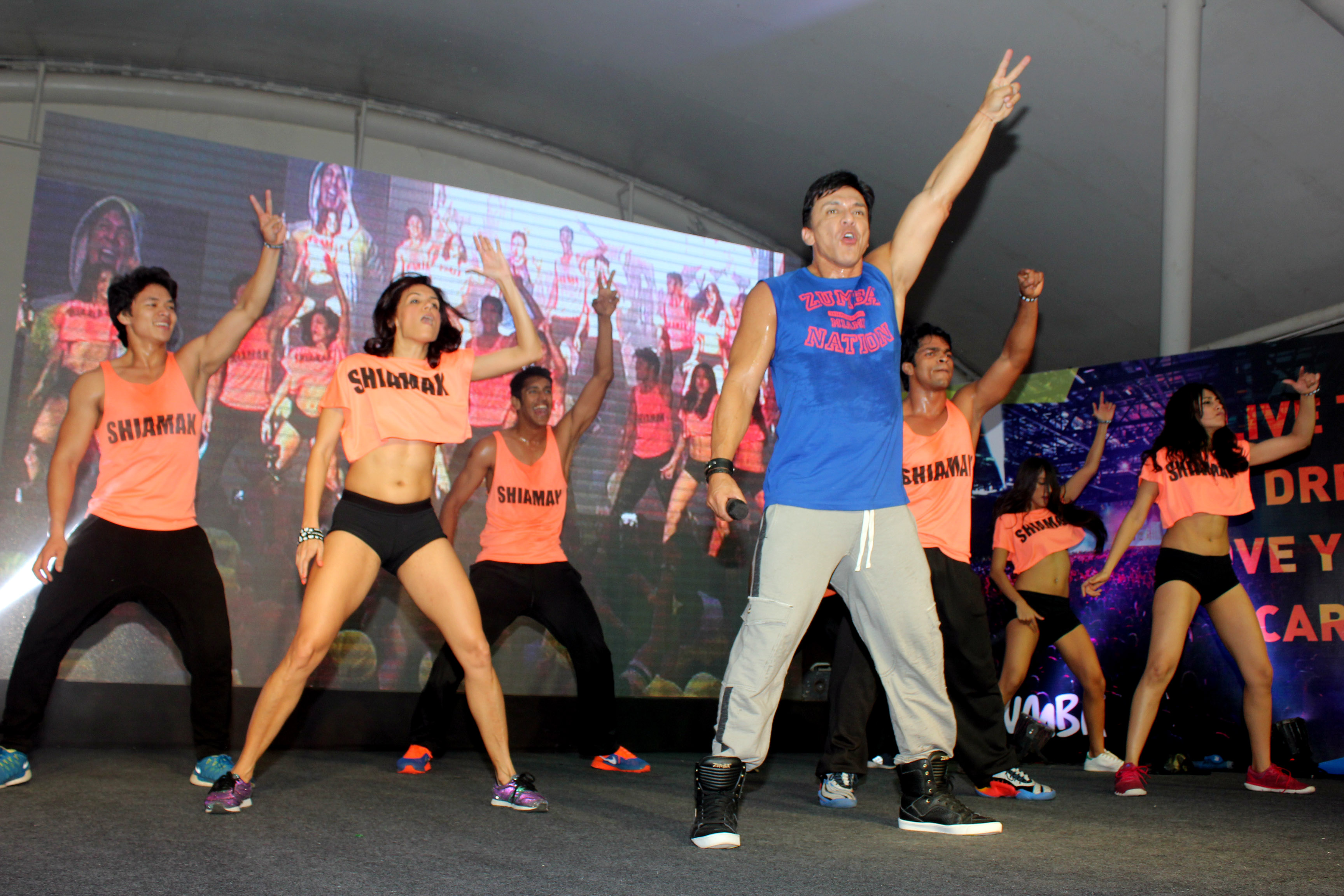 Beto Perez on stage with SHIAMAK instructors who are Zumba certified