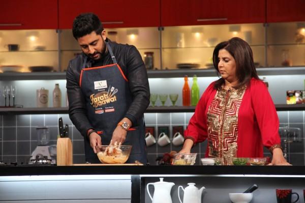 Abhishek cooks while Farah looks on