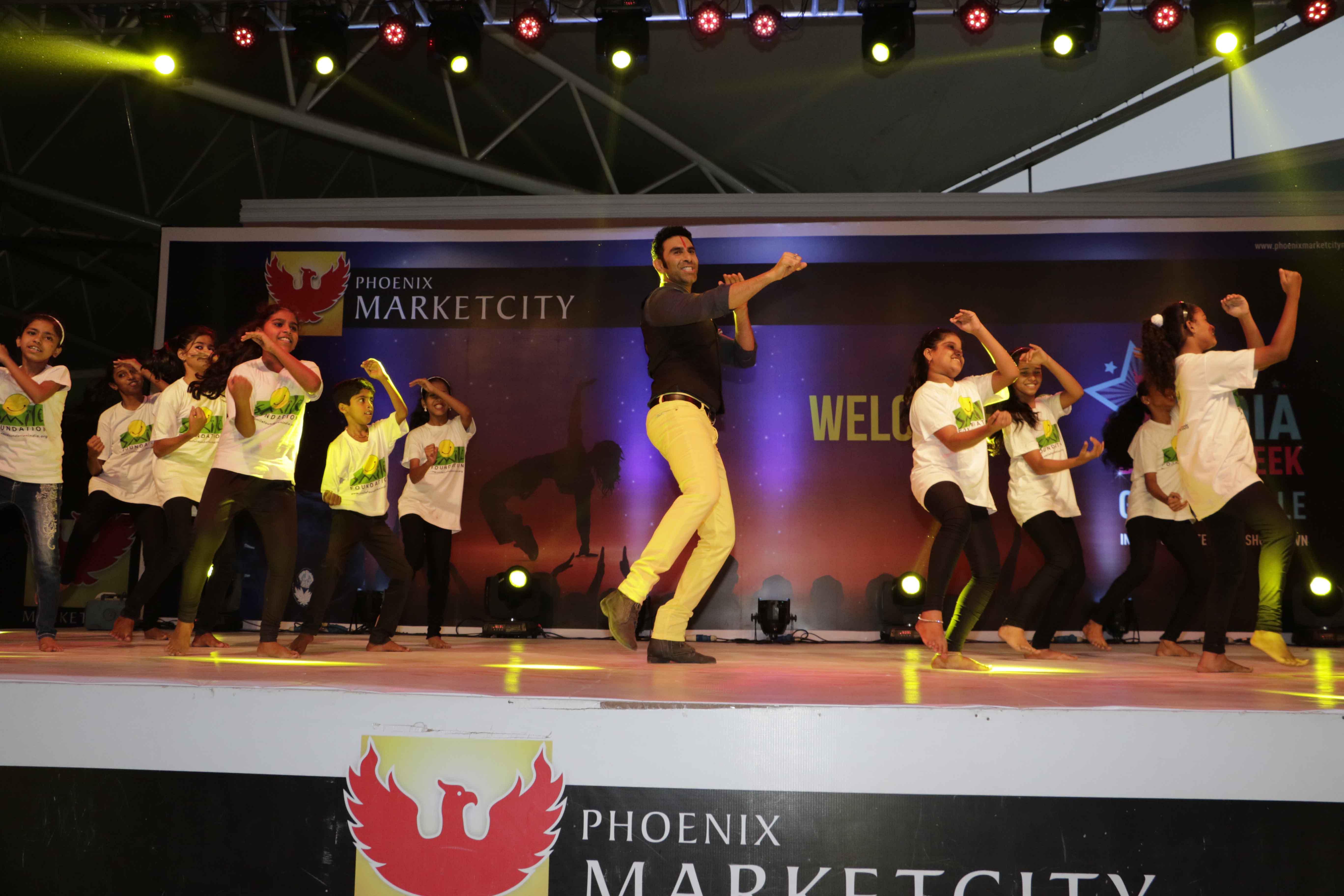 Sandip Soparrkar performing with Smile Foundation Children1