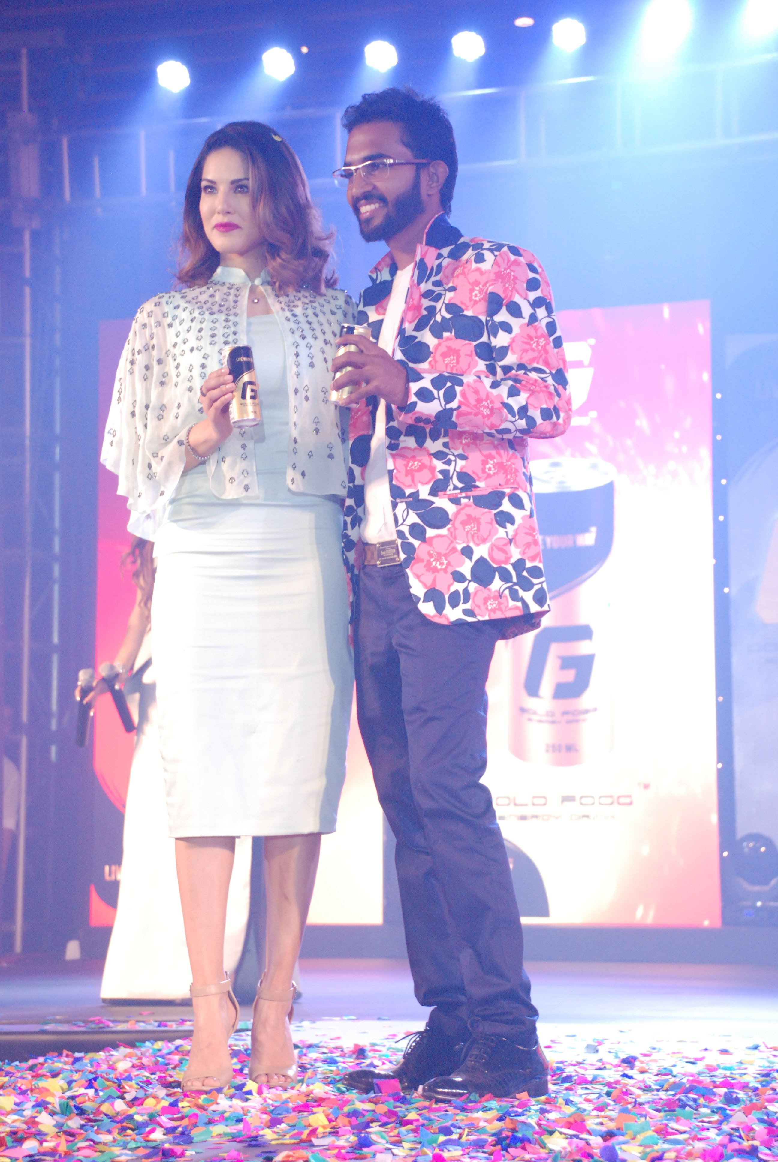 Bollywood actress Sunny Leone seen with Rahul Vinayika, MD of RZ International Pvt Ltd during the launch of Gold Fogg, an energy drink in Bengaluru on Sunday 3