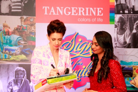 Kalki signs for a CSR initative by Tangerine to donate bedsheets to oldage homes