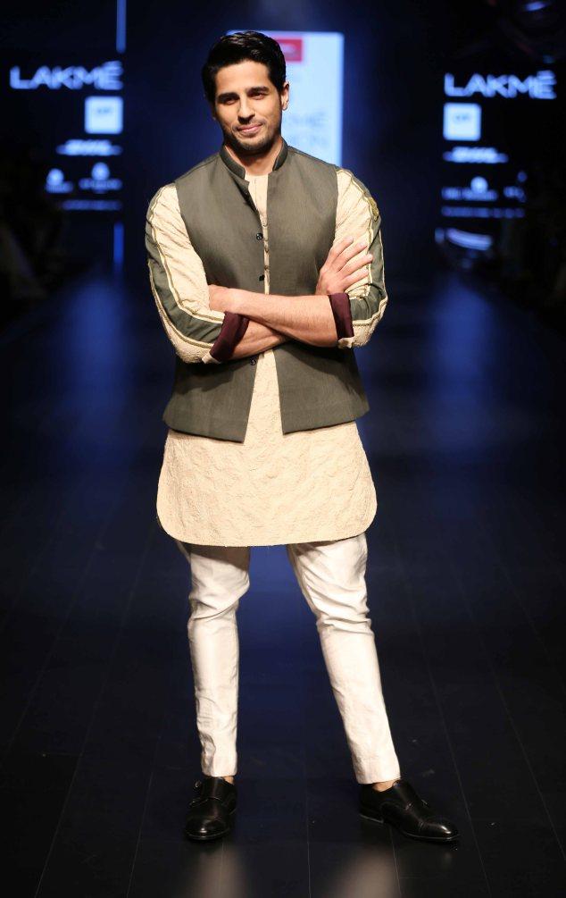 Actor Siddharth Malhotra walks the ramp for Kunal Rawal at LFW SR 2016