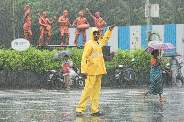 Traffic cop during pouring rains at Juhu crossing