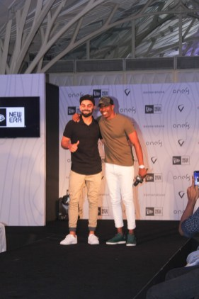 Virat Kohli and Dwayne Bravo at the launch of Virat's headgear collection 1
