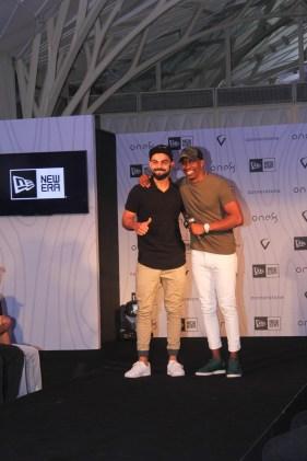 Virat Kohli and Dwayne Bravo at the launch of Virat's headgear collection