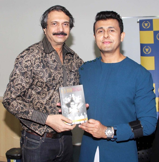 Author Chaitanya Padukone presents a copy of RD BurMania to celebrated singer-actor Sonu Nigam.
