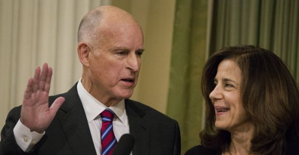 With wife Anne Gust looking on, Democratic Gov. Jerry Brown is sworn into office in the Assembly chamber at the state capitol on Monday. (BLOOMBERG)