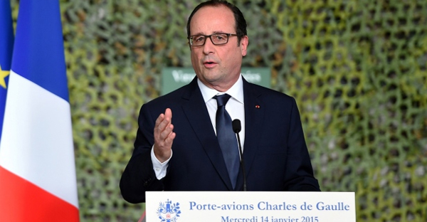 French President Francois Hollande reviews the troops during his visit on the French nuclear aircraft carrier Charles de Gaulle to present his New Year wishes to the French military forces, off the coast of Toulon, southern France, Wednesday, Jan.14, 2015. (AP / Anne Christine Poujoulat)