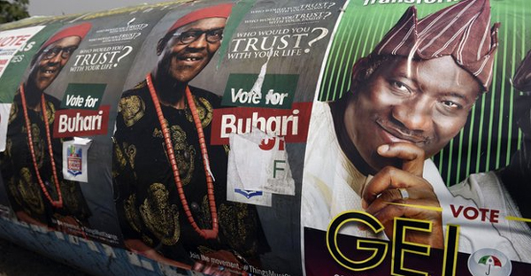 President Jonathan and his challenger Muhammadu Buhari are appealing to the religious vote in Jos (AFP)