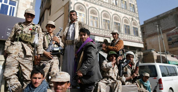 Houthi fighters Wednesday in the streets of Sana, the Yemeni capital. They now control the city. (Khaled Abdullah/Reuters)
