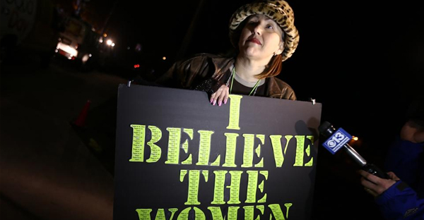 The only protester at the Bill Cosby show in Turlock Community Theater, Suzette Sims, holds a sign that says 'I believe the women.' (SPLASH NEWS)