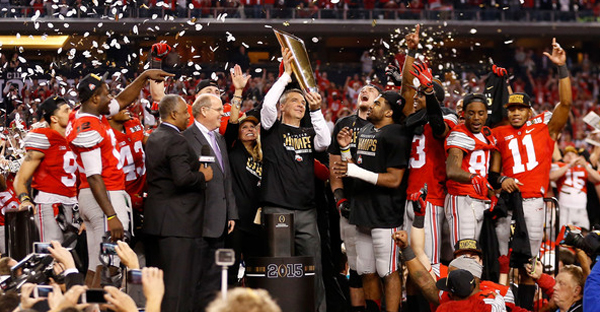 Head Coach Urban Meyer of the Ohio State Buckeyes hoist the trophy after defeating the Oregon Ducks 42 to 20 in the College Football Playoff National Championship Game at AT&T Stadium on January 12, 2015 in Arlington, Texas. (Christian Petersen/Getty Images North America)
