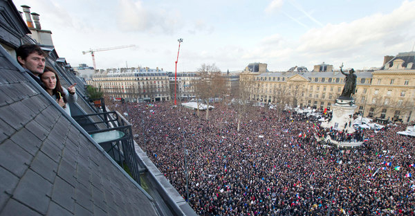 From a rooftop window, a view of the people who swarmed the Place de la République on Sunday for a rally described as the largest in modern French history. (Peter Dejong/Associated Press)