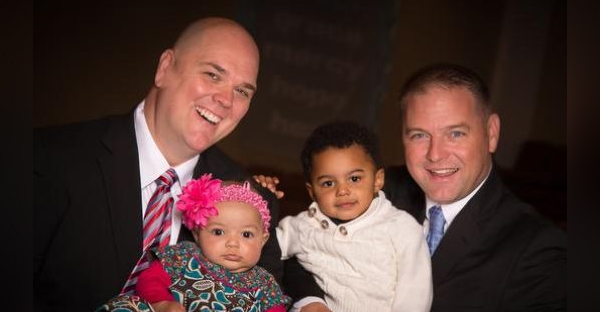 Brian Copeland holds daughter Esther as husband Greg Bullard holds son Micah. (Submitted)
