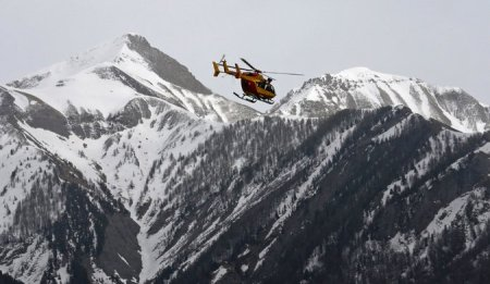 A rescue helicopter over the French Alps near the crash site of the Airbus A320 on Tuesday. Credit Jean-Paul Pelissier/Reuters