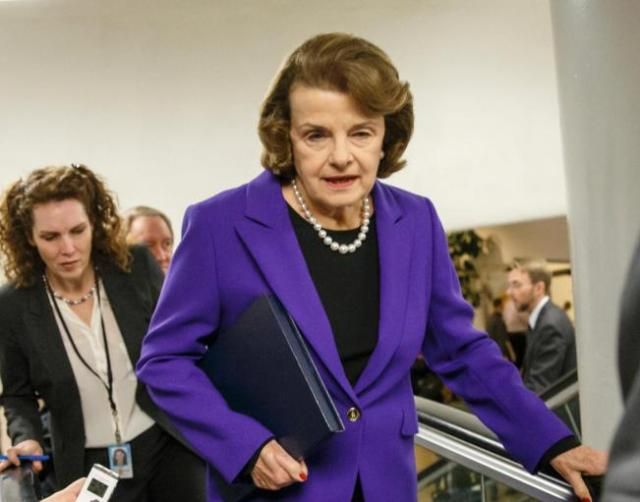 FILE - In this Dec. 9, 2014 file photo, Sen. Dianne Feinstein, D-Calif. is pursued by reporters on Capitol Hill in Washington. The Senate doesn't agree on much, but they agreed the wanted a law to help the victims of sex trafficking. However, the bill got caught up in the emotional and uncompromising politics of abortion. Feinstein, in a remarkable exchange on the Seante floor, told Sen. John Cornyn, R-Texas, the lead GOP sponsor of the Justice for Victims of Trafficking Act, that women have lost too many fights over abortion already and would not back down. (AP Photo/J. Scott Applewhite, File)