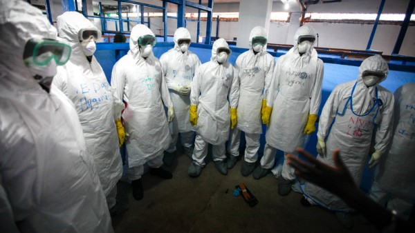 Health workers suit up for Ebola duty in Monrovia, Liberia. John W. Poole/NPR