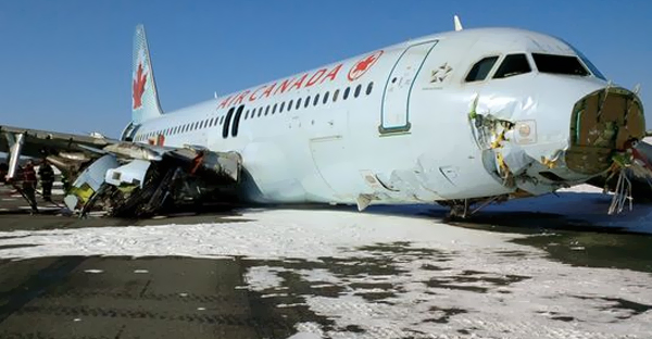This March 29, 2015, handout photo provided by the Canada Transportation Safety Board shows damage to an Air Canada Airbus A-320 that skidded off the runway at Halifax International Airport in Nova Scotia. (PHOTO CREDIT: AFP/Getty Images)