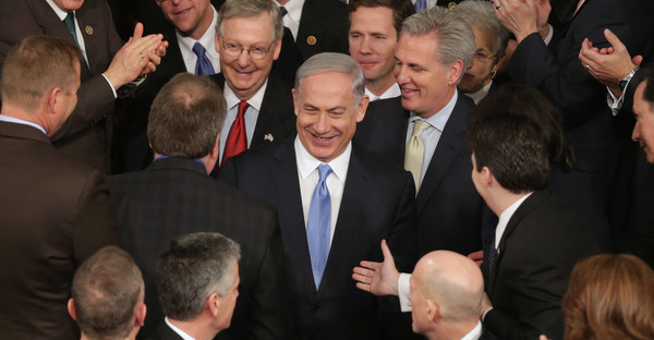 Israeli Prime Minister Benjamin Netanyahu is greeted by members of Congress as he arrives to speak during a joint meeting of the United States Congress in the House chamber at the U.S. Capitol March 3, 2015 in Washington, DC. (Chip Somodevilla/Getty Images North America)