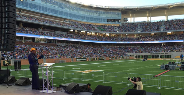 Tony Evans proclaims the name of Jesus Christ to thousands gathered in Waco, Texas, at McLane Stadium. (photo by Oak Cliff Bible Fellowship/Facebook)
