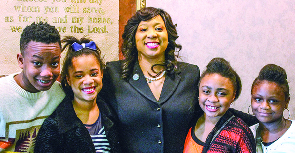State Sen. Anastasia Pittman, D-Oklahoma City, poses with children at the Northeast Church of Christ before the church's Sunday morning worship assembly. (PHOTO BY BOBBY ROSS JR.)