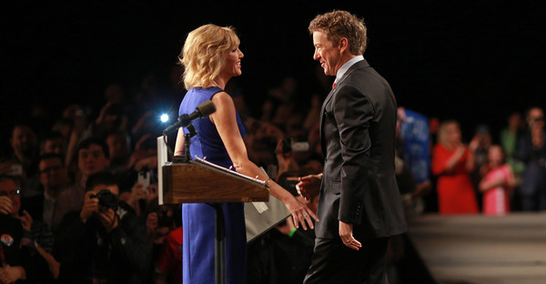 Sen. Rand Paul (R-KY) smiles at his wife Kelley Paul before announcing his candidacy for the Republican presidential nomination during an event at the Galt House Hotel on April 7, 2015 in Louisville, Kentucky. (Luke Sharrett/Getty Images North America)