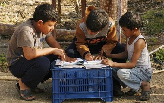 Boys do homework at a U.N. camp for Syrian refugees in southern Lebanon, April 14, 2015. More than 15 million children in the Middle East are not being educated, despite advances in efforts to expand schooling, the U.N. children's agency said. (Mahmoud Zayyat / AFP / Getty Images)